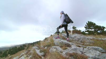 Day hiking woman on top of mountain plateau Ai-Petri crane shot