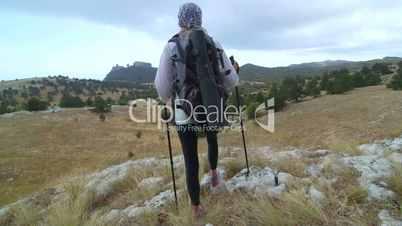 JIB CRANE: Day hiking woman walking off trail at mountain plateau Ai-Petri