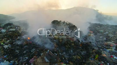 Toxic smoke from burning dump rises into the air