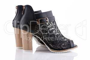 Female shoes with black lace, white sole and a wooden heel, isol