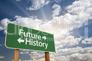 Future and History Green Road Sign Over Clouds
