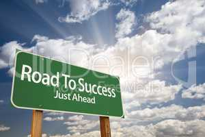 Road To Success Green Road Sign Over Clouds