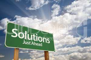 Solutions Green Road Sign Over Clouds