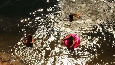 joy children swimming in the river