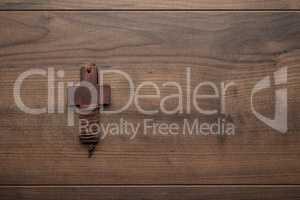 cross over brown wooden background