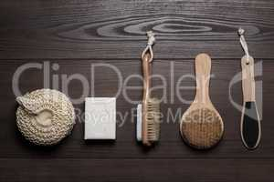 bath accessories on the brown wooden background