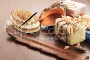 bath and spa accessories on brown wooden background