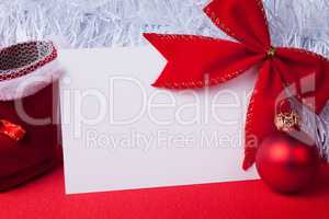 greeting card and christmas decoration on the red background