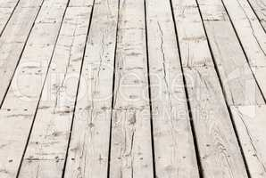 Cracked weathered wood deck boards