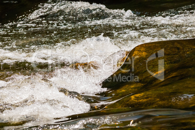 Flowing and splashing river water