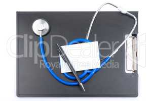 Clip board with stethoscope and white sheet of paper