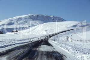 Snowy road in wintertime