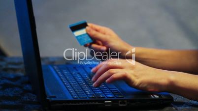 Business woman with laptop and credit card. Online payment and mobile banking.