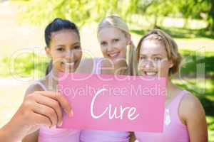 Cure against smiling women in pink for breast cancer awareness