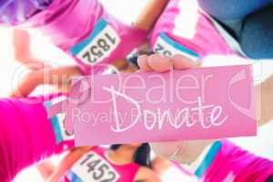 Donate against five smiling runners supporting breast cancer mar