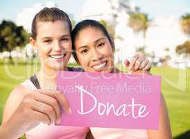 Donate against two smiling women wearing pink for breast cancer