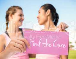 Find the cure against two smiling women wearing pink for breast