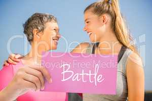 Battle against sporty mother and daughter smiling at each other