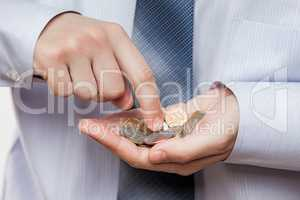 Business man hand holding coin savings counting money profit or
