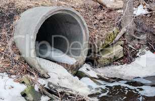 Concrete sewer culvert emptying in winter