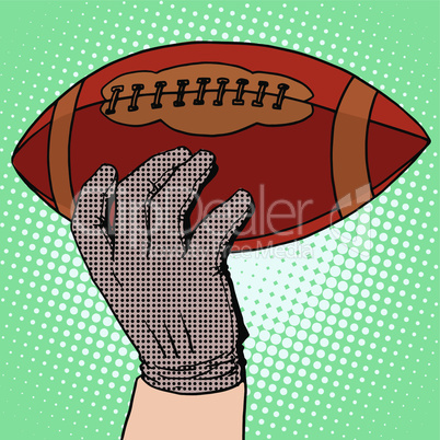 The ball of American football in his hand