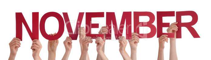 Many People Hands Holding Red Straight Word November