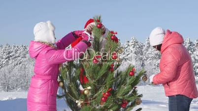 Family Christmas holidays recreational activity in winter forest