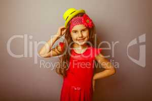 Girl European appearance haired child of seven years in a bright
