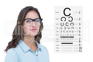 Composite image of pretty geeky hipster looking at camera