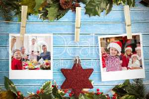 Composite image of hanging christmas photos