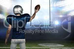 Composite image of rear view of sports player holding ball