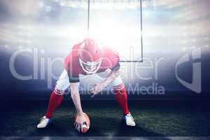 Composite image of american football player starting football ga