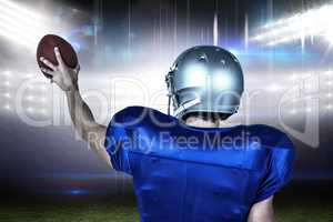 Composite image of sports player holding ball