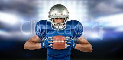 Composite image of portrait of confident sports player holding b