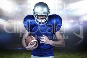 Composite image of confident sports player holding ball