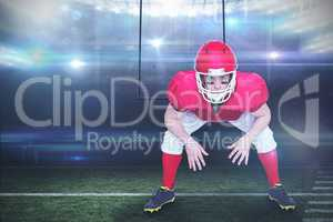 Composite image of american football player in attack stance