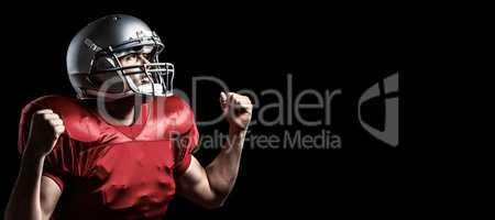 Composite image of american football player cheering with clench