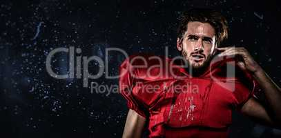 Composite image of wet american football player in red jersey lo