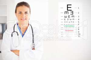 Composite image of charming doctor having a stethoscope around h