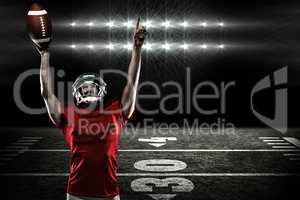 Composite image of american football player with holding ball ar