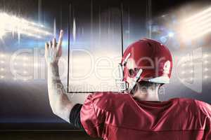 Composite image of rear view of american football player triumph