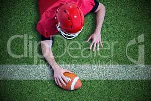 Composite image of american football player trying to score