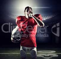 Composite image of thirsty sportsman in red jersey holding helme