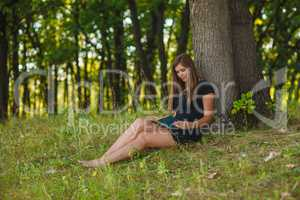Girl European appearance young brown-haired woman in a black dre