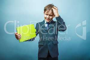 Teen boy businessman European appearance in a business suit hold