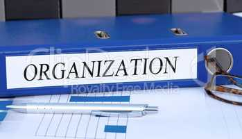 Organization - blue binder in the office