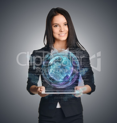 Young girl holding tablet in hands of virtual digital globe and computer code