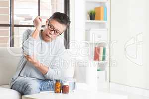 Mature Asian man elbow pain