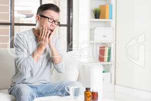 Mature Asian man toothache