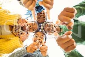 Young family doing a head circles and pointing the camera